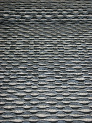 Strickstoff grau/blau/schwarz Struktur Wellen
